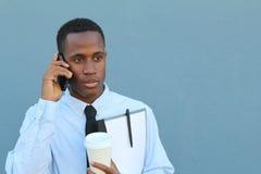 在电话的被聚焦的商人 免版税库存图片