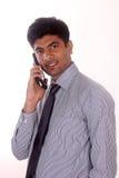 在电话的年轻商人 图库摄影
