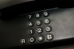 在电话的黑键盘 免版税库存图片
