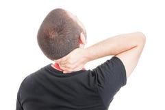 在男性雇员的背面图以脖子伤 免版税库存照片