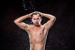 在男性面孔的水飞溅 免版税库存图片