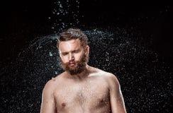在男性面孔的水飞溅 库存照片