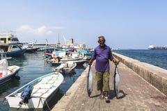 在男性,马尔代夫的捕鱼港口 库存照片