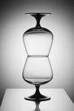 在白光的空的玻璃 免版税库存图片