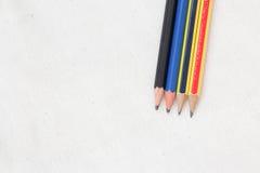 在白棉布的铅笔 图库摄影