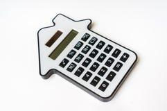 在白的房地产、租约和抵押概念的计算器 免版税库存照片