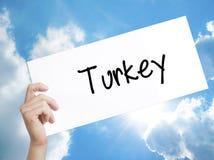 在白皮书的土耳其标志 人手对负纸与文本 我 库存例证