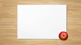 在白皮书的红色苹果计算机 库存照片