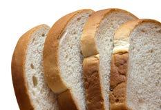 在白色上添面包 库存照片