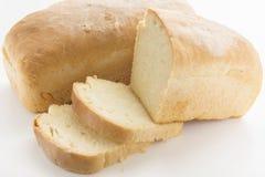 在白色上添面包 库存图片