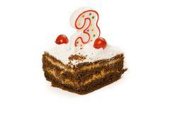 在白色与蜡烛第三的生日蛋糕隔绝的 库存图片