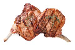 在白色关闭隔绝的烤猪肉两个片断  库存照片