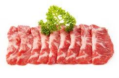 在白色切的牛肉 免版税库存图片