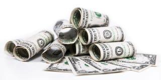 在白色前面的一美元钞票 免版税图库摄影