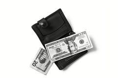 在白色后面地面和钱包图片的$ 100, 免版税库存图片