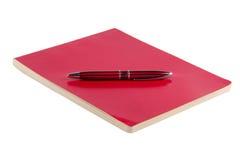 在白色和笔隔绝的笔记薄 免版税库存照片