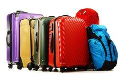 在白色和背包隔绝的手提箱 图库摄影