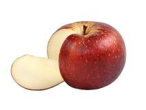 在白色和苹果四分之一查出的一个红色苹果 库存照片