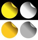 在白色和黑背景的金黄和银色贴纸 免版税图库摄影