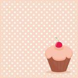 在白色圆点桃红色背景的杯形蛋糕 图库摄影