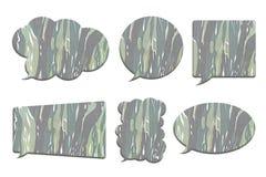 在白色在泡影讲话形状的伪装隔绝的 免版税库存图片