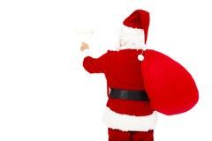 在白色墙壁上的圣诞老人绘画 免版税图库摄影