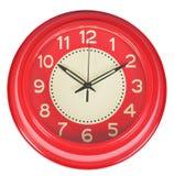 在白色墙壁上的红色经典时钟 免版税库存图片