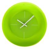 在白色墙壁上的绿色经典时钟 免版税库存照片