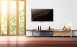 在白色墙壁空的客厅内部的电视 库存图片