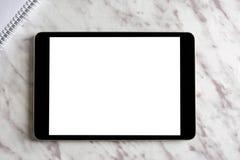 在白色大理石顶部的空的普通片剂个人计算机 免版税库存图片