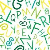 在白色字母表的无缝的传染媒介绿色在pa上写字 免版税库存照片