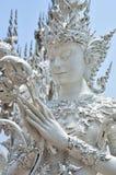 在白色寺庙,清莱的菩萨雕象 免版税库存图片