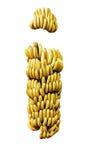 在白色成熟成熟黄色隔绝的香蕉树束 免版税库存照片