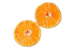 在白色成熟蜜桔隔绝的切片 免版税库存图片