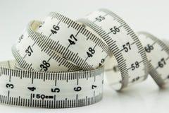 措施磁带或厘米被隔绝在白色 免版税库存照片