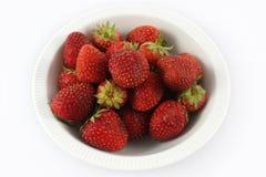 在白色打击的腐烂的老草莓在白色背景 免版税库存照片