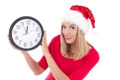 在白色有时钟摆在的隔绝的圣诞老人帽子的美丽的妇女 库存图片