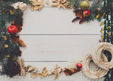 在白色木背景拷贝空间的圣诞节装饰手工制造框架 图库摄影