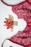 在白色木背景的性感的红色鞋带女用贴身内衣裤 Fasion wo 免版税库存图片