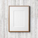 在白色木背景的木制框架 库存照片