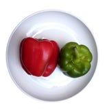 在白色板材的红色和青椒 库存图片