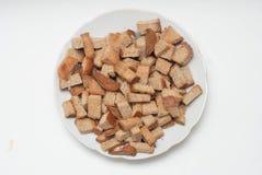 在白色板材的自创被烘烤的新鲜的薄脆饼干在白色背景 健康的食物 顶视图 查出 免版税库存图片