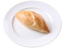 在白色板材的面包 免版税库存照片