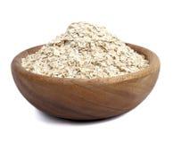 在白色查出的一碗燕麦 免版税库存图片