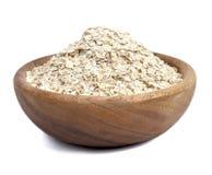 在白色查出的一碗燕麦 免版税库存照片
