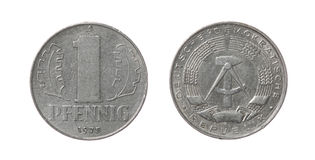 在白色查出的东德硬币 库存图片