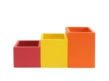 在白色查出的五颜六色的配件箱 免版税库存图片