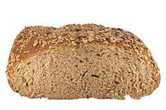 在白色查出的全部的谷物面包 免版税库存照片