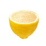 在白色查出的半新鲜的黄色柠檬 库存照片