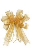 在白色查出的发光的金黄圣诞节弓 库存照片